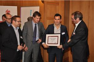 Olivier Coredo (IDC), Mathieu Breton (SwissLife) et Sylvain Fievet (pour action !) ont remis le prix de la start-up de l'année à Loïc  Deo Van, cofondateur de ByPath. © Dorian Marcellin